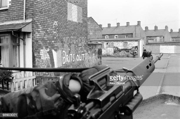 A British Army mobile patrol moves past IRA graffiti in the Republican Ardoyne district of north Belfast 19th April 1976
