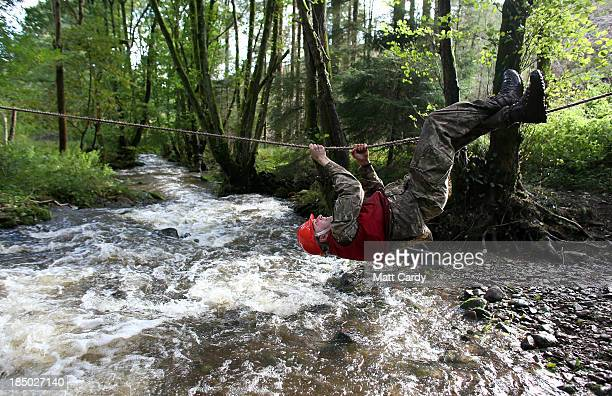 British Army officer cadet from the Royal Military Academy Sandhurst crosses a river during a command task as he takes part in Exercise Long Reach in...