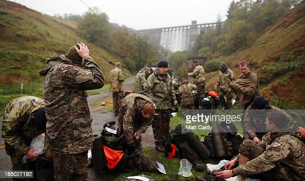 British Army officer cadets from the Royal Military Academy Sandhurst, change their clothes as they take a break before begining a command task at a...