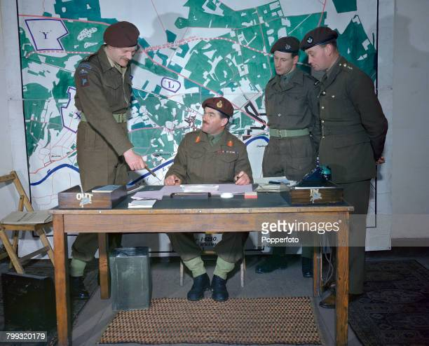 British Army officer Major General Roy Urquhart General Officer Commanding of the 1st Airborne Division pictured seated with his staff in front of a...