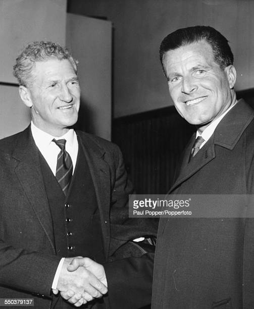British army officer Sir John Hunt and mountaineer Norman Dyhrenfurth pictured shaking hands both men having successfully scaled Mount Everest at...