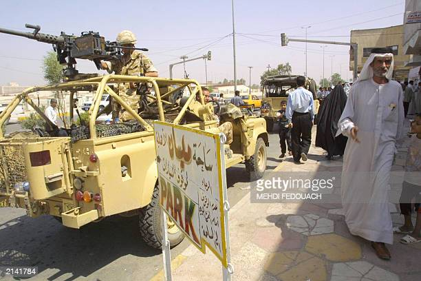A British army patrol drives through the streets of the southern town of Amara some 200 kms north of Iraq's second largest city of Basra 25 June 2003...