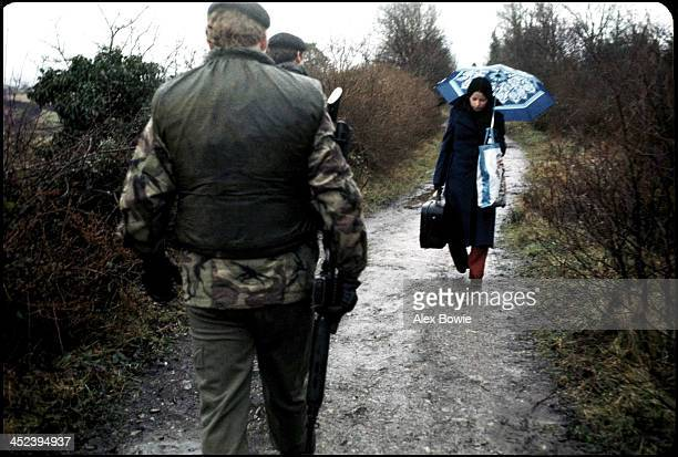 A British Army patrol meets a woman as she enters Northern Ireland from the Republic of Ireland along an unauthorised road closed to traffic 28...