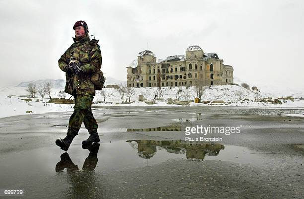 British Army Private Kevin Mc Laren from London patrols the snow covered streets by the Darulaman Palace February 8 2002 in Kabul Afghanistan More...