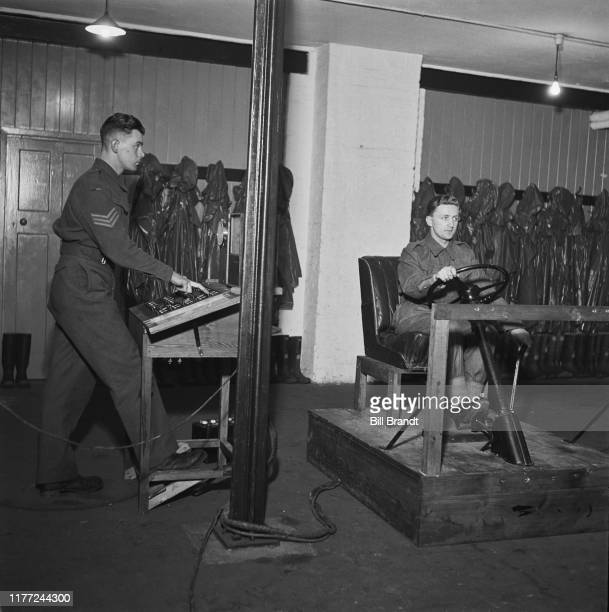 A British Army recruit undergoes suitability and aptitude training to drive vehicles under the instruction of sergeant at a military camp somewhere...