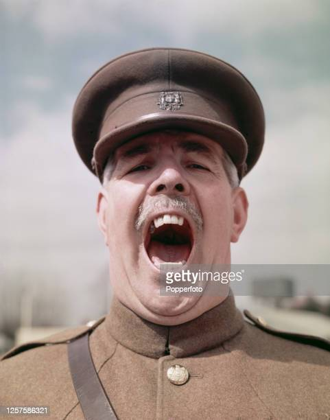 British Army Regimental Sergeant Major Ronald Brittain barks orders on a parade ground in England in July 1955. Ronald Brittain appears as himself in...