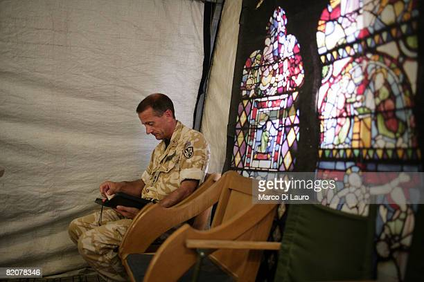 British army Reverend LtCol Nicholas Cook Chaplain to the Forces from the Royal Army Chaplains Department prays in the tent functioning as the Chapel...