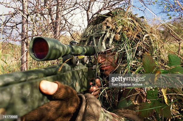 British army sniper camouflaged during training in concealment techniques, May 1990.