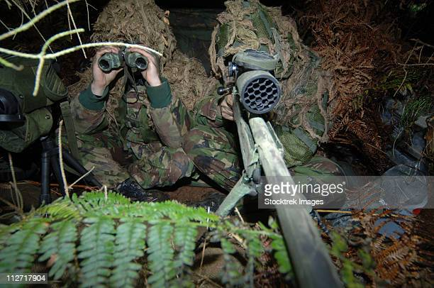 A British Army sniper team dressed in ghillie suits.