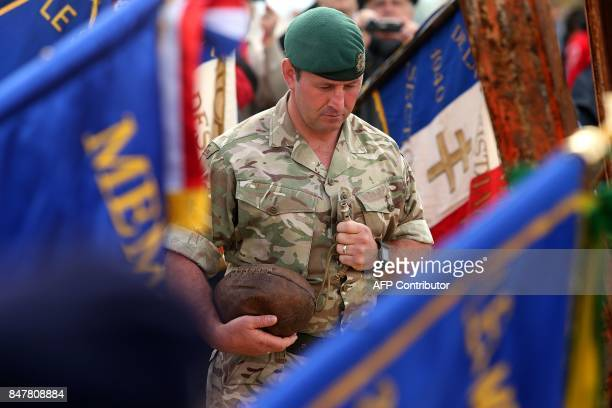 British army soldier carries a rugby ball and whistle, dating from WWI, during the inauguration of a monument, created by French former rugby player...