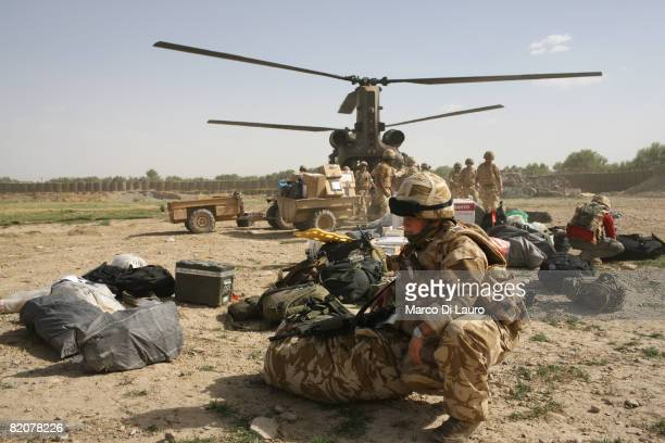 British Army soldier deployed from a Chinook helicopter that just landed at Forward Operation Base Sangin Dc on July 22, 2008 in Sangin DC, Helmand...