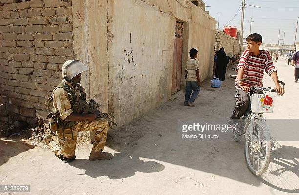 British army soldier from the 1st Cheshire Regiment is seen securing the area near a school which has been opened with the financial support of the...