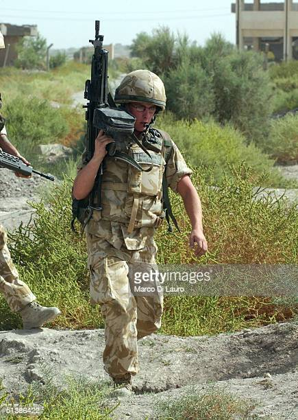 British army soldier from the 1st Cheshire Regiment patrols the street October 3, 2004 in the southern town of Basrah, Iraq.