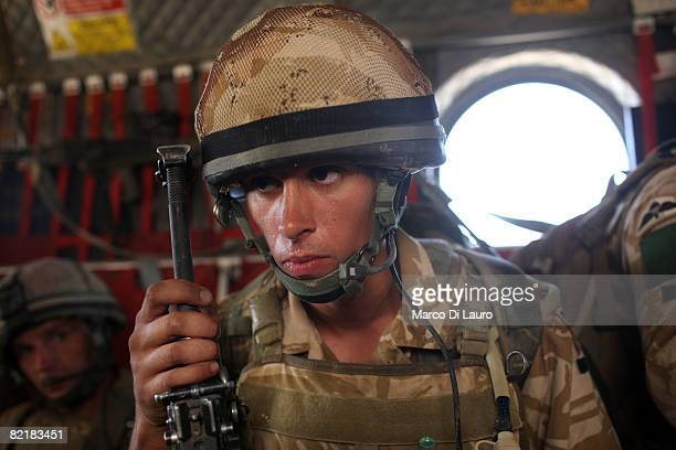British Army soldier from the 3rd Battalion The Parachute Regiment deploys on a chinook helicopter during strike operation Southern Beast on August 1...