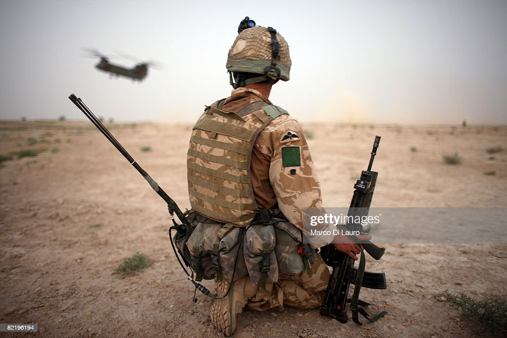 A British Army soldier from the 3rd Battalion The Parachute Regiment secures the helicopter landing strip (HLS) during operation Southern Beast on August 6, 2008 in Maywand District in Kandahar Province, Afghanistan. The British Army soldiers from the 3rd Battalion The Parachute Regiment spearheaded a strike operation in the Maywand District of the Kandahar Province, setting the conditions for a permanent ISAF presence to support the Afghan National Government in their fight against the Taliban. Striking within one of Afghanistan's major opium producing areas the Paratroopers were looking for weapons, drugs, and individuals related to the Taliban. During the operation about seventy kilograms of opium was seized and some weapons were recovered.