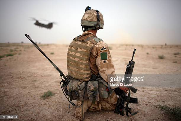 British Army soldier from the 3rd Battalion The Parachute Regiment secures the helicopter landing strip during operation Southern Beast on August 6,...