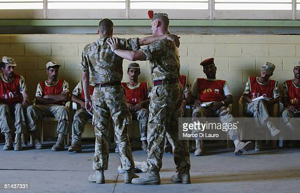 British army soldier from the Black Watch Regiment teaches body search class to the Iraqi National Guard during a Junior Command and Leadership...