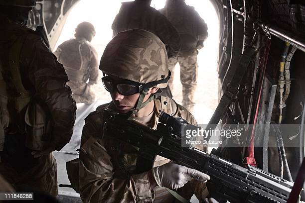 British Army soldier SAC Chris Thynne, 19-years-old from the RAF 34 SQN at Leeming member of the Immediate Response Team secures the ground as the...