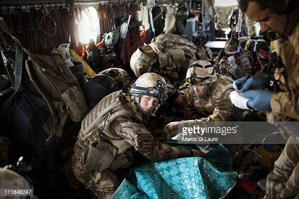 British Army soldier Signaler Neil Mackie, 26-years-old and MERT members onboard of the MERT CH-47 Chinook helicopter treat two wounded British...