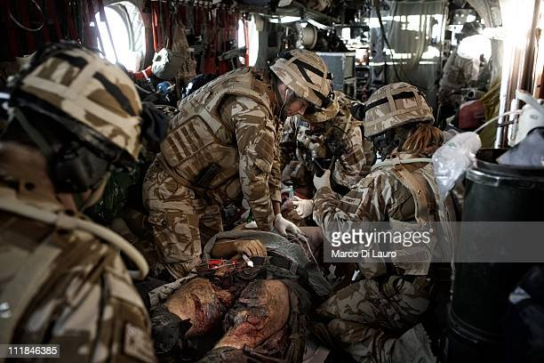 British Army soldier Signaler Neil Mackie 26yearsold and MERT members onboard of the MERT CH47 Chinook helicopter perform a cardiopulmonary...