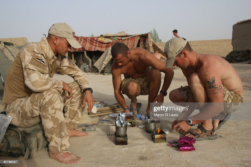British Army soldiers from the 3rd Battalion The Parachute Regiment cook their 'ready to eat' individual meal rations during operation Southern Beast on August 6, 2008 in Maywand District in Kandahar Province, Afghanistan. The British Army soldiers from the 3rd Battalion The Parachute Regiment spearheaded a strike operation in the Maywand District of the Kandahar Province, setting the conditions for a permanent ISAF presence to support the Afghan National Government in their fight against the Taliban. Striking within one of Afghanistan's major opium producing areas the Paratroopers were looking for weapons, drugs, and individuals related to the Taliban. During the operation about seventy kilograms of opium was seized and some weapons were recovered.