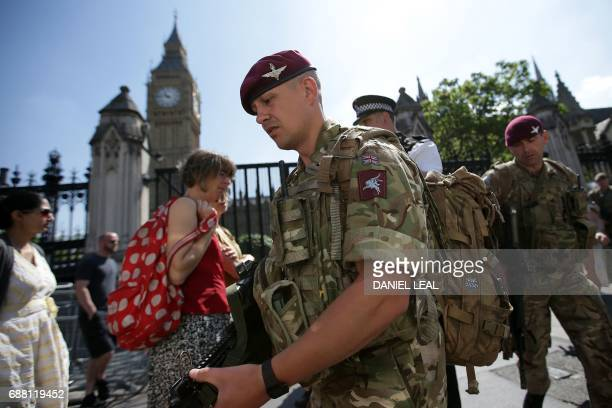 British Army soldiers from the Parachute regiment patrol the streets near the Palace of Westminster comprising the Houses of Parliament and the House...