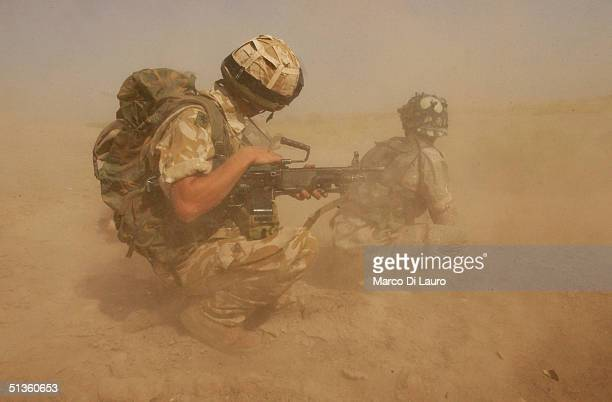 British Army soldiers, from the Royal Welch Fusiliers Regiment and Iraqi National Guards, take defensive positions on September 26, 2004 in Al...