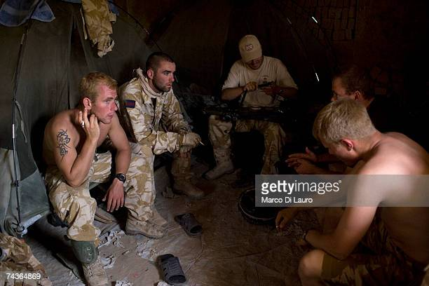 British Army soldiers of the Inkerman Company 1st Battalion Grenadier Guards Regiment talk to each other during 'Lastay Kulang' operation in Blenheim...