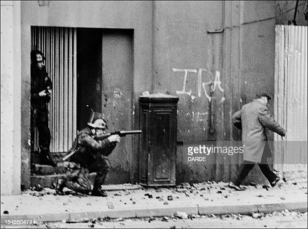 British army soldiers patrol 04 November 1971 in the Bogside quarter of the city of Londonderry during heavy clashes between the Catholic minority...