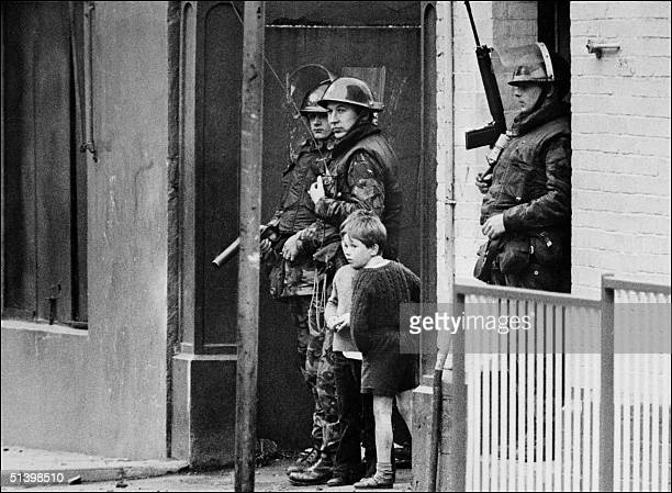 British army soldiers patrol 26 August 1971 in the Bogside quarter of the city of Londonderry during heavy clashes between the Catholic minority...