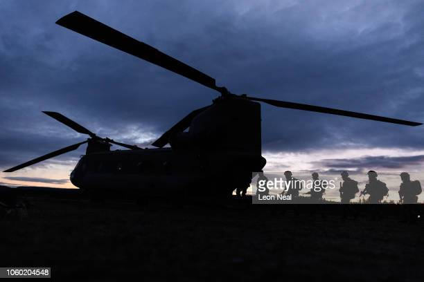 British Army soldiers take part in helicopter drills using a United States Army Chinook CH47 helicopter during preexercise integration training on...