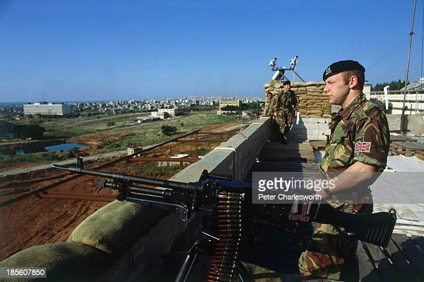 British army soldiers with an M60 machine gun on guard on the roof of the British Army's headquarters near Hadath Beirut gets a protective face lift...