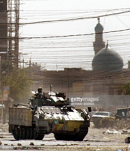 British army tank patrols a street of the southern Iraqi city of Basra during clashes with Iraqi Shiite Muslims followers of radical Shiite leader...