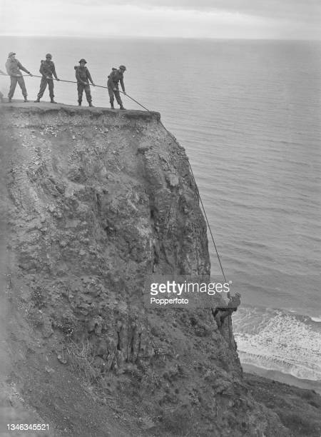 British Army trainee PT instructors take part in a cliff climbing exercise as part of a physical fitness course near a Royal Army Physical Training...