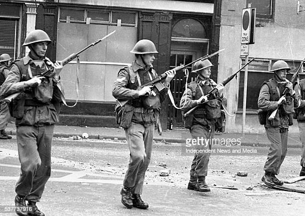 British Army troops patrol the streets after being deployed to end the Battle of the Bogside Derry Northern Ireland mid to late August 1969 The...