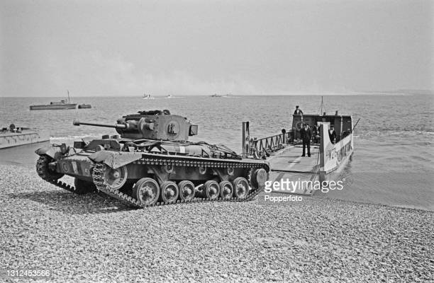 British Army Valentine tank drives off a Royal Navy Landing Craft Mechanized as part of a large scale amphibious landing invasion exercise on a beach...