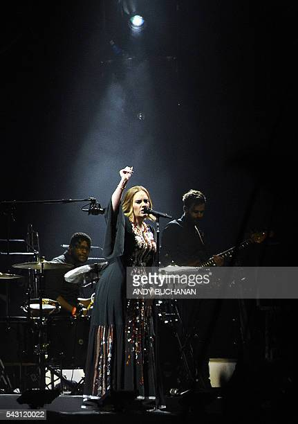 British artist Adele performs on the Pyramid Stage at the Glastonbury on day four of the Glastonbury Festival of Music and Performing Arts on Worthy...