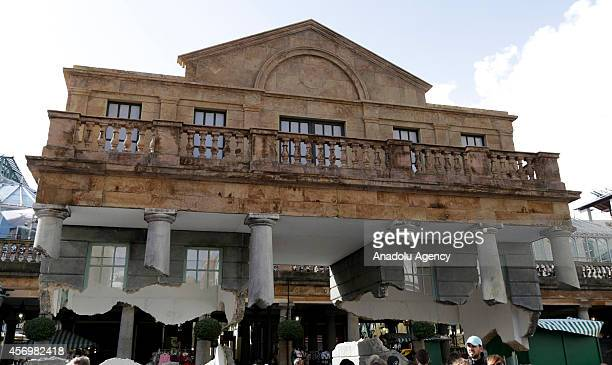 British artist Alex Chinneck's installation called 'Take my lightning but dont steal my thunder' stands in Covent Garden London England on October 9...