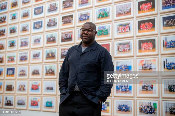 British artist and filmmaker Steve McQueen poses at the Tate Britain at the opening of a photographic project to take pictures of all Year 3 school...
