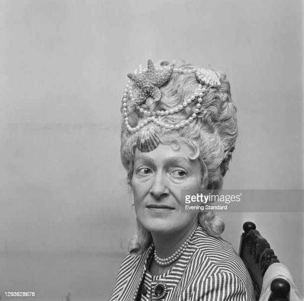British artist Angela Sykes , Countess of Antrim, UK, 4th July 1966. She is the wife of Randal McDonnell, 8th Earl of Antrim. She is wearing her hair...