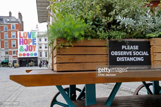 British artist Anthony Burrill unveils four storey tall outdoor art installation, with the words Love, Hope & Joy at Covent Garden on June 30, 2020...