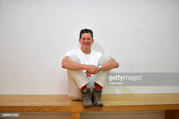 British artist Antony Gormley poses for a photograph at the launch of his artwork entitled 'Object 199' a lifesize castiron sculpture cast from the...