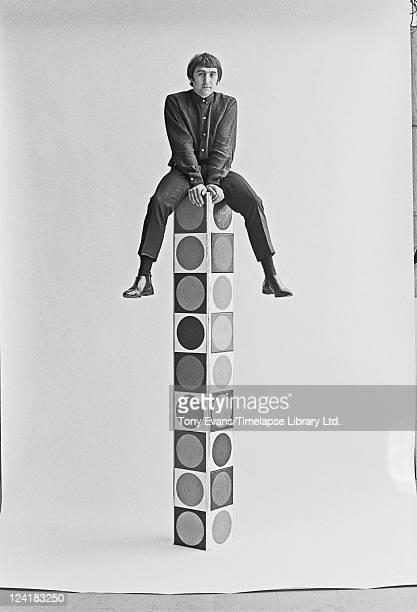 British artist Brian Rice sitting on a pop art piece 1965