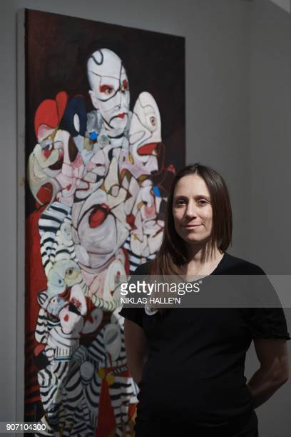British artist Dannielle Hodson poses for a photograph next to her painting titled, The Flasher, at Sotheby's auction house in central London on...
