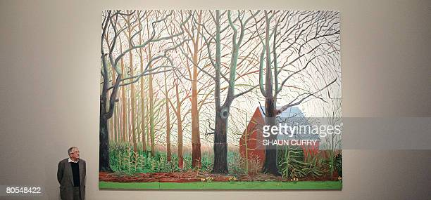 British artist David Hockney poses for photographs next to a segment of his painting entitled 'Bigger Tree's near Warter' at the Tate Britain in...