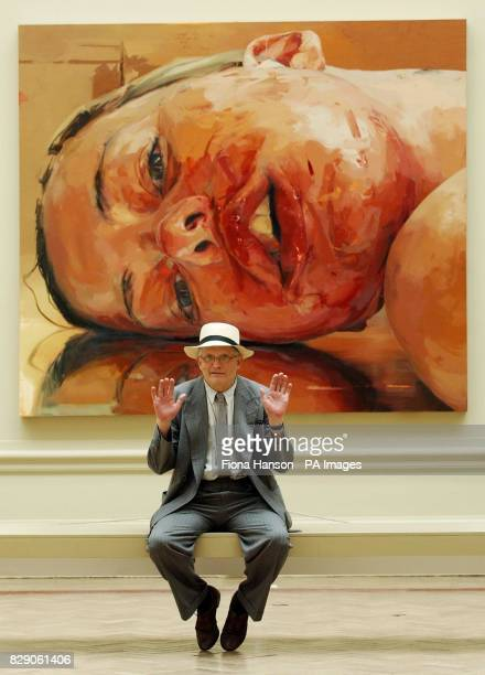 British artist David Hockney seated in front of 'Reverse' a work by Jenny Saville at the Royal Academy's Summer Exhibition in Piccadilly London which...