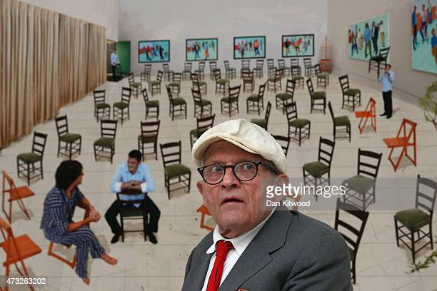 British artist David Hockney sits in front of a works entitled 'Sparer Chairs' during the launch of his new exhibition 'Paintings and Photography' at...