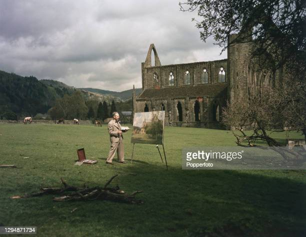 British artist Donald Henry Floyd paints the ruins of Tintern Abbey from the south, near the village of Tintern in Monmouthshire, Wales in June 1947.