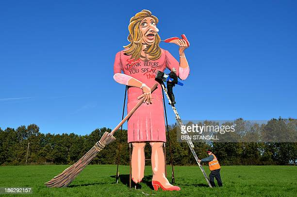 British artist Frank Shepherd of the Edenbridge Bonfire Society puts the finishing touches to a giant effigy of British former Apprentice contestant...