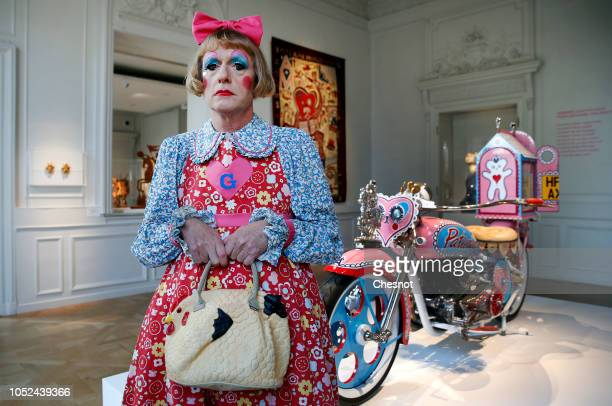 British artist Grayson Perry poses in front of his art work Kenilworth AM1 2010 a customised motorcycle during a press visit of his exhibition Vanity...